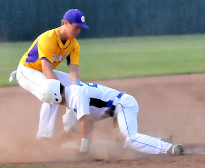 Drew Tipton slides into third base. (Photo by Kevin Nagle)