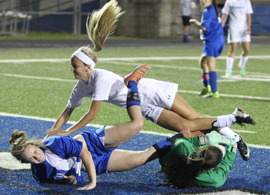 Anna Lowery gets tangled up with a pair of Conway players on her second-half goal. (Photo by Rick Nation)