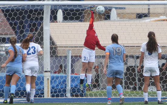 Bryant's junior keeper Kayla Dreher (31) leaps and reaches for a Fort Smith Southside shot Friday. (Photo by Rick Nation)