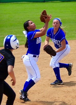 Sarah Evans settles under a pop up as Mallory Theel backs up. (Photo courtesy of Jon Staton)