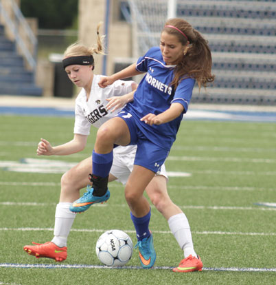 Allison Hughes contends for possession during Saturday's Class 7A State Tournament semifinal. (Photo by Kenzi Brenton)