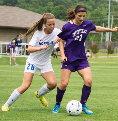 Jessica Butler (26) defends Fayetteville's Mariam Bartlett (21). (Photo courtesy of Bill Birnie/NWA Democrat-Gazette)
