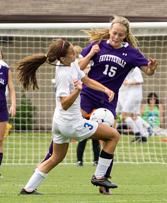 Hadley Dickinson (3) gets tangled up with Fayetteville's Myra Tubb (15) during Saturday's State championship match. (Photo courtesy of Bill Birnie/NWA Democrat-Gazette)