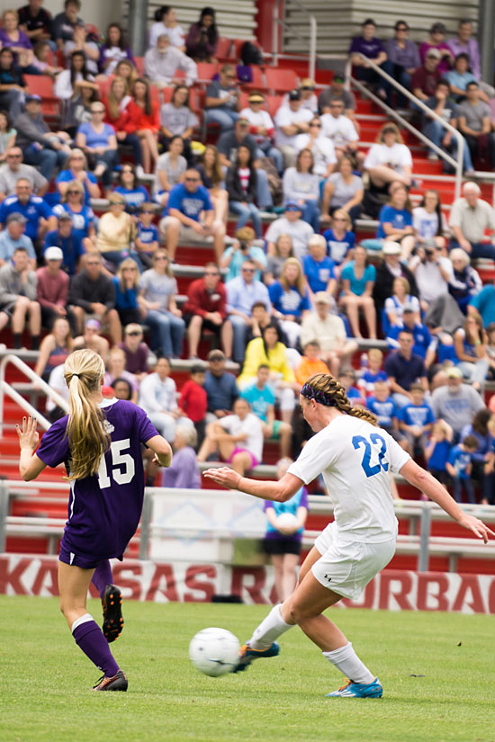 The big crowd at Saturday's championship match watches as Bryant's Brittney Sahlmann (22) tries to get past Fayetteville's Myra Tubb. (Photo courtesy of Bill Birnie/NWA Democrat-Gazette)