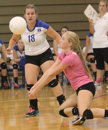 Whitney Brown digs up a hit as teammate Kaci Squires (18) looks on. (Photo by Rick Nation)