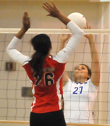 Bryant's Alex Dillard (27) battles at the net. (Photo by Kevin Nagle)