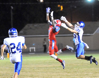 Nick Hardin (24) trails the play as Bryant's Pierce Finney (16) and McClellan's Jaylin Cunningham (9) leap up for a pass. (Photo by Kevin Nagle)