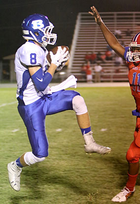 Aaron Orender (8) hauls in one of his seven receptions. (Photo by Rick Nation)