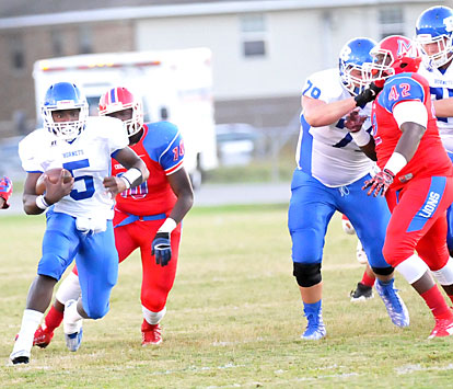 DeAmonte Terry (5) takes advantage of a block by Cole Fritschen (79). (Photo by Kevin Nagle)