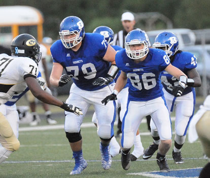 Cole Frischen (79), Janet Jacobs (86) and DeMaja Price (42) lead the blocking. (Photo by Kevin Nagle)