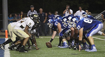 The Bryant offensive line digs in against Central's defensive front moments before a touchdown. (Photo by Rick Nation)