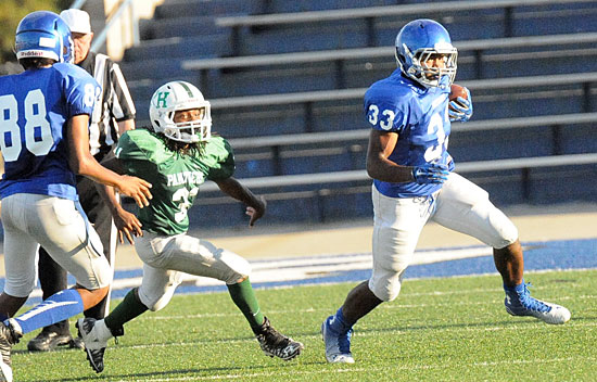 Running back Ahmad Adams (33) turns the corner on a sweep. (Photo by Kevin Nagle)