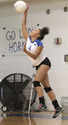 Savannah Shelton serves during Tuesday's match. (Photo by Rick Nation)