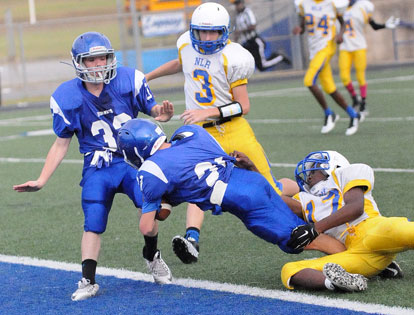 Bethel's Hayden Holt (21) falls forward into the end zone on a touchdown pass with teammate Dalen McDonald (32) on hand. (photo by Kevin Nagle)
