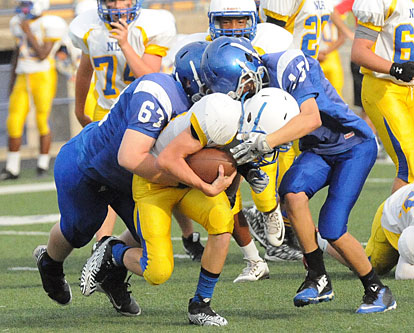 Bethel's Tanner Wilson (67) and Ryan Riedmueller (15) make a tackle. (Photo by Kevin Nagle)