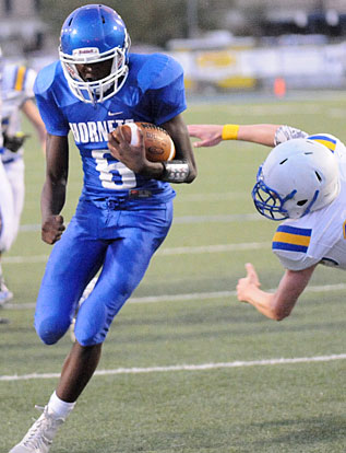 Randy Thomas heads to the end zone past a North Little Rock defender. (Photo by Kevin Nagle)