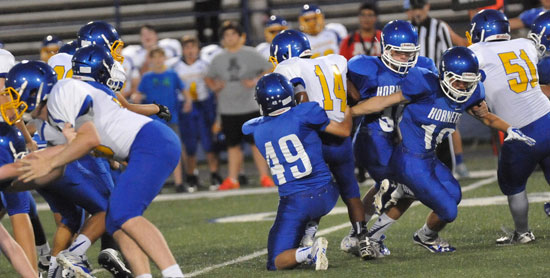 Ryan Lessenberry (49) makes a tackle during Tuesday night's game. (Photo by Kevin Nagle)