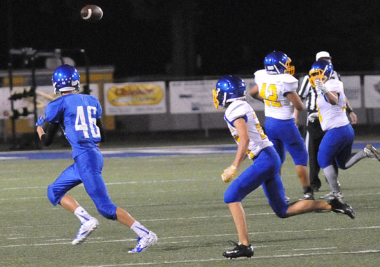 Micah Van Roekel (46) tracks a pass into the flat. (Photo by Kevin Nagle)