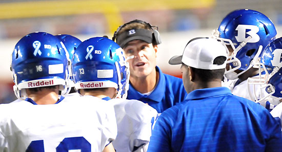 Coach Paul Calley instructs a group of his players. (Photo by Kevin Nagle)