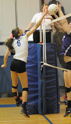 Allie Anderson (6) contends with a pair of Mount St. Mary blockers. (Photo by Kevin Nagle)