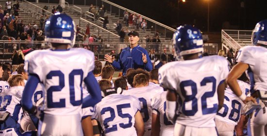 Bryant head coach Paul Calley addresses his team after Friday night's loss at Greenwood. (Photo by Rick Nation)