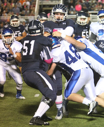 Bryant's Peyton Robertson (48) and Walker Brown (51) make a stop. (Photo by Rick Nation)