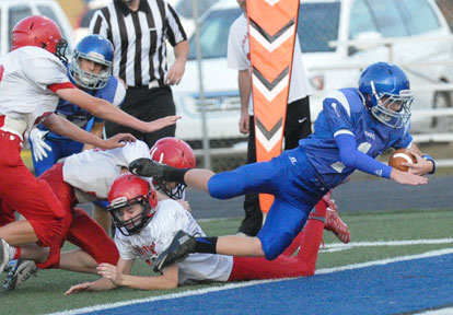Bethel quarterback Jake Meaders (1) dives into the end zone on a run that was negated by penalty. (Photo by Kevin Nagle)