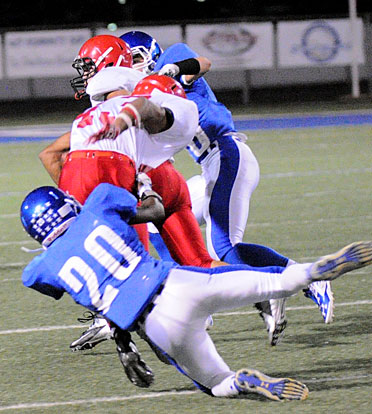 K.J. Terry (20) hauls down Cabot Red's Tadariyan Rogers. (Photo by Kevin Nagle)