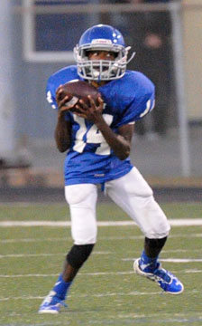 Arlon Jenkins looks for running room after catching a pass. (Photo by Kevin Nagle)