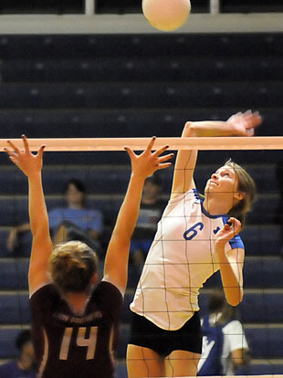 Allie Anderson goes up for one of her 24 kills. (Photo by Kevin Nagle)