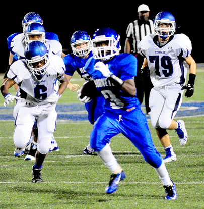 Keethan Hudson (3) starts his first touchdown run. (Photo by Kevin Nagle)