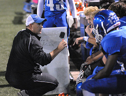 Bryant coach John Orr talks to his defense on the sideline during Thursday night's game. (Photo by Kevin Nagle)