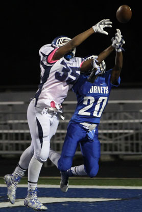 Bryant's K.J. Terry (20) contends with Conway White's Terry Clardy for a pass into the end zone. (Photo by Rick Nation)