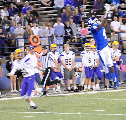Quentin Royal (4) goes high for an interception in front of Catholic's Preston Wilson (81). (Photo by Kevin Nagle)