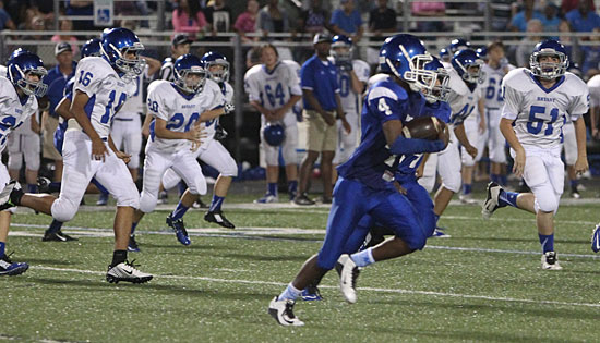 Bryant Blue's Christian Cain (4) heads upfield on his 72-yard kickoff return pursued by Bryant White's Maliki Griffin (16), jonathan Ray (20) and Luke Staton (51). (Photo by Rick Nation)