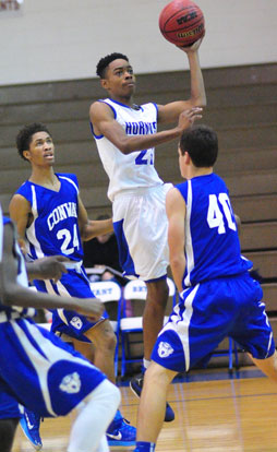Josh Robinson (21) tries to finish off a drive the hoop. (Photo by Kevin Nagle)