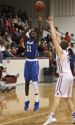 Kevin Hunt fires up a jumper over Benton's Westin Riddick. (Photo by Rick Nation)
