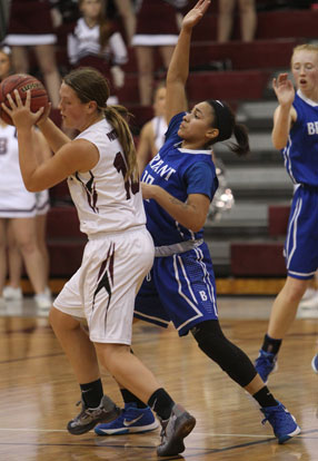 Emily Ridgell puts pressure on Benton's Taylor Oglesby, left. (Photo by Rick Nation)