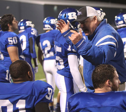 Defensive line coach Brad Stroud instructs on the sideline. (Photo by Rick Nation)