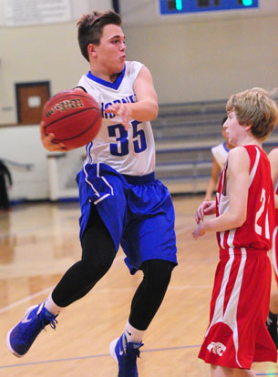 Cade Brennan (35) looks to get a pass past a Cabot North player. (Photo by Kevin Nagle)