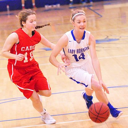 Meagan Chism (14) drives around a Cabot defender. (Photo by Kevin Nagle)