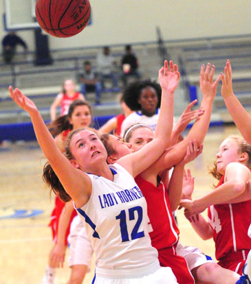 Megan Lee goes after a rebound in a crowd of players. (Photo by Kevin Nagle)