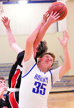 Blaise Smith (35) battles for a rebound. (Photo by Kevin Nagle)