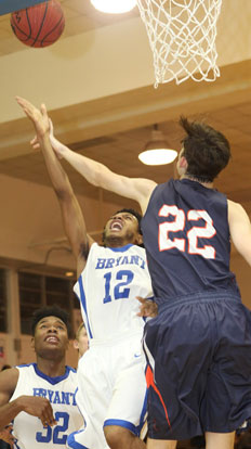 Bryant's Christian Macintosh (12) puts a shot up after grabbing an offensive rebound. (Photo by Rick Nation)