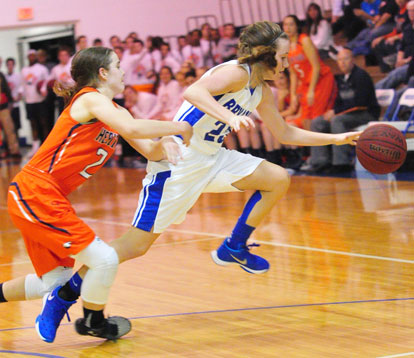 Bryant's Kendal Rogers controls the ball against pressure from a Rogers Heritage defender. (Photo by Kevin Nagle)