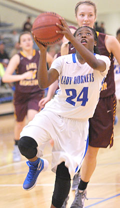 Kali Walker (24) drives to the basket. (Photo by Kevin Nagle)