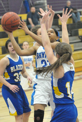 Destiny Martin (21) goes up for a shot inside. (Photo by Kevin Nagle)
