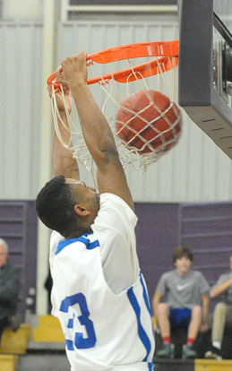 Romen Martin finishes off a dunk. (Photo by Kevin Nagle)