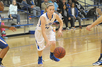 Meagan Chism starts a drive to the basket. (Photo by Kevin Nagle)