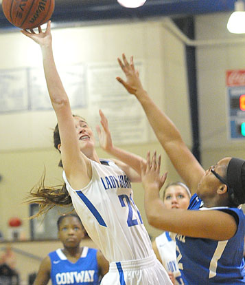 Mary Catherine Selig (21) tries to score over a Conway Blue defender. (Photo by Kevin Nagle)